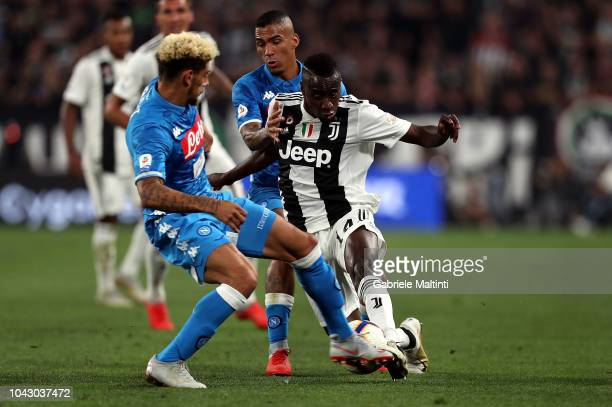 Blaise Matuidi of Juventus battles for the ball with Allan and Kevin Malcuit of SSC Napoli during the Serie A match between Juventus and SSC Napoli...