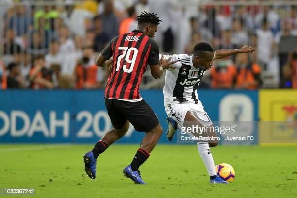 Blaise Matuidi of Juventus competes for the ball with Franck Kessié of AC Milan during the Italian Supercup match between Juventus and AC Milan at...