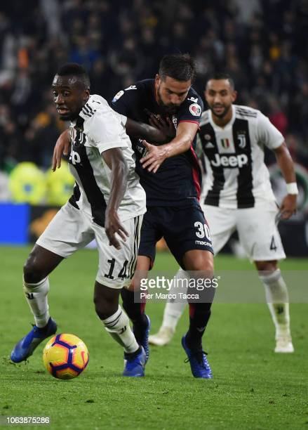 Blaise Matuidi of Juventus competes for the ball with Leonardo Pavoletti of Cagliari during the Serie A match between Juventus and Cagliari on...