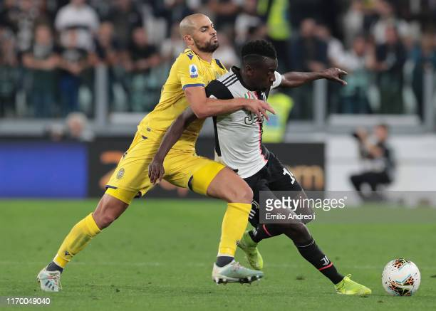 Blaise Matuidi of Juventus competes for the ball with Sofyan Amrabat of Hellas Verona during the Serie A match between Juventus and Hellas Verona at...