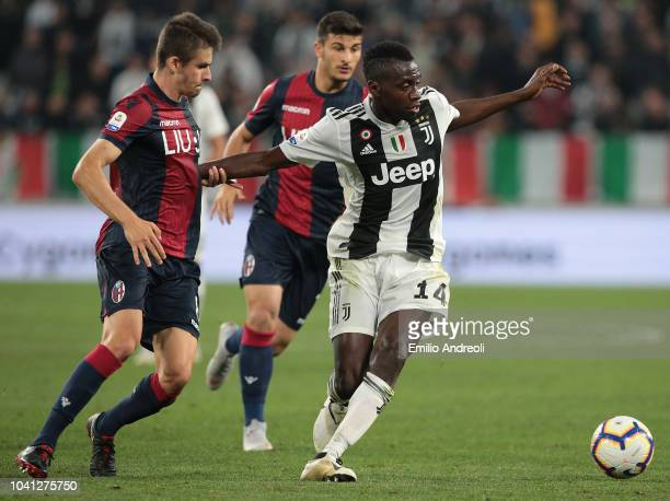Blaise Matuidi of Juventus FC is challenged by Adam Nagy of Bologna FC during the Serie A match between Juventus and Bologna FC at Allianz Stadium on...