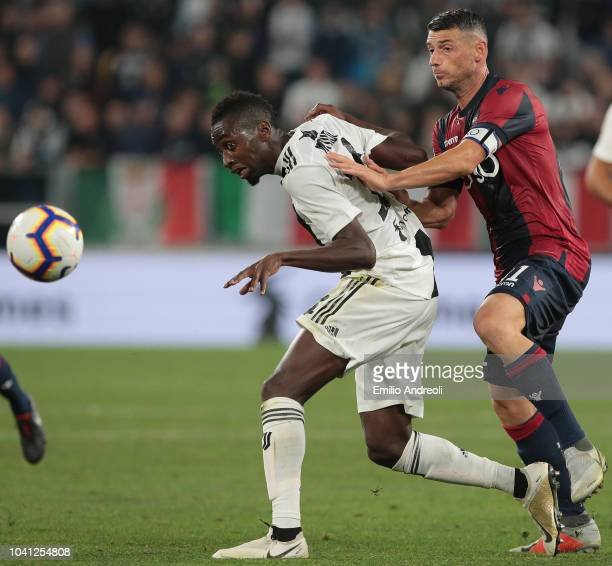 Blaise Matuidi of Juventus FC is challenged by Blerim Dzemaili of Bologna FC during the Serie A match between Juventus and Bologna FC at Allianz...