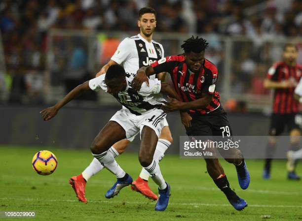 Blaise Matuidi of Juventus fights for the ball with Franck Kessie of AC Milan during the Italian Supercup match between Juventus and AC Milan at King...