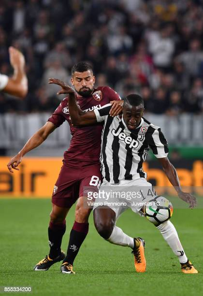 Blaise Matuidi of Juventus is challenged by Tomas Rincon of Torino FC during the Serie A match between Juventus and Torino FC on September 23 2017 in...