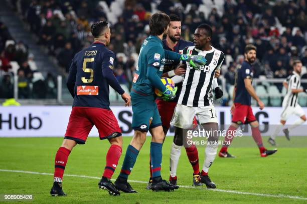 Blaise Matuidi of Juventus is held back by Nicolas Spolli of Genoa CFC as he argues with Armando Izzo of Genoa CFC during the Serie A match between...