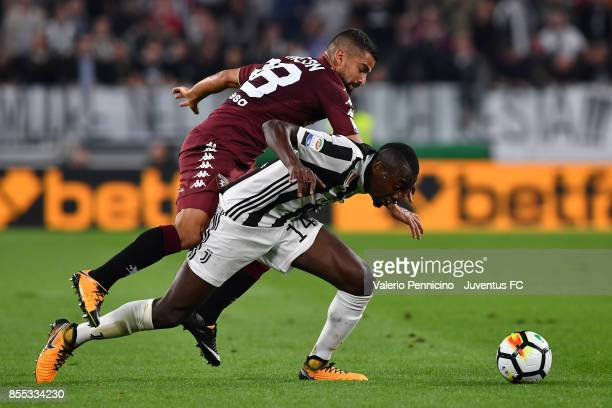 Blaise Matuidi of Juventus is tackled by Tomas Rincon of Torino FC during the Serie A match between Juventus and Torino FC on September 23 2017 in...