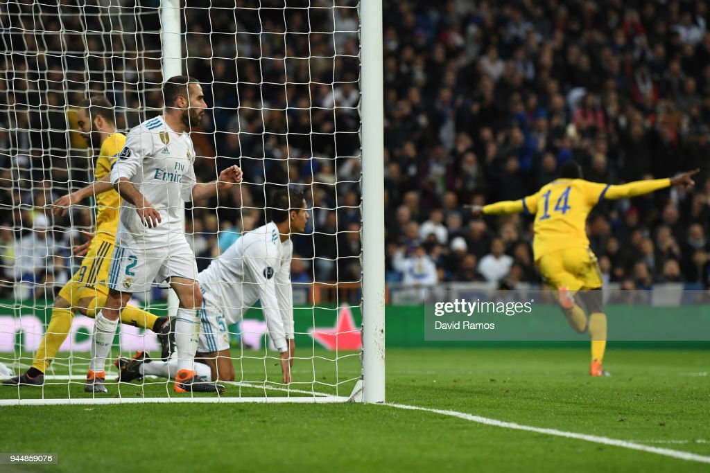 Blaise Matuidi of Juventus scores his sides third goal, whilst Daniel Carvajal of Real Madrid looks dejected from the back of the net during the UEFA Champions League Quarter Final Second Leg match between Real Madrid and Juventus at Estadio Santiago Bernabeu on April 11, 2018 in Madrid, Spain.