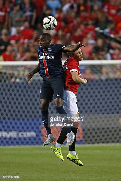Blaise Matuidi of Paris SaintGermain and Bastian Schweinsteiger of Manchester United battle for a header during a match in the 2015 International...