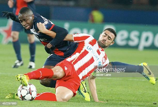 Blaise Matuidi of Paris SaintGermain and captain Giannis Maniatis of Olympiacos FC during the UEFA Champions League between Paris SaintGermain FC and...