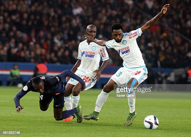 Blaise Matuidi of Paris SaintGermain in action with Nicola Nkoulou and Lassana Diarra of Olympique de Marseille during the French Ligue 1 between...