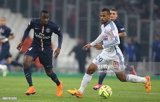Blaise Matuidi of PSG and JacquesAlaixys Romao of OM in action during the French Ligue 1 match between Olympique de Marseille and Paris SaintGermain...