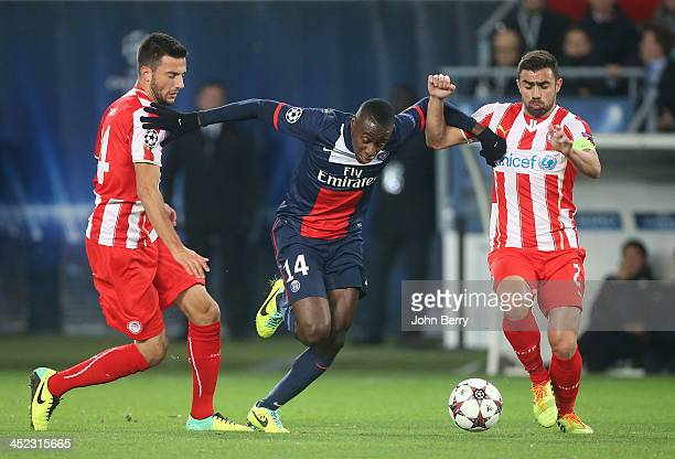 Blaise Matuidi of PSG in action between Andreas Samaris and Giannis Maniatis of Olympiacos during the UEFA Champions League Group C match between...
