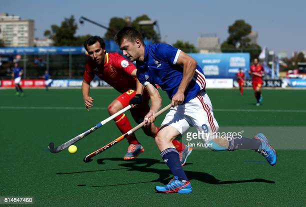 Blaise Rogeau of France controls the ball from Sergi Enrique of Spain during day 4 of the FIH Hockey World League Men's Semi Finals Pool A match...