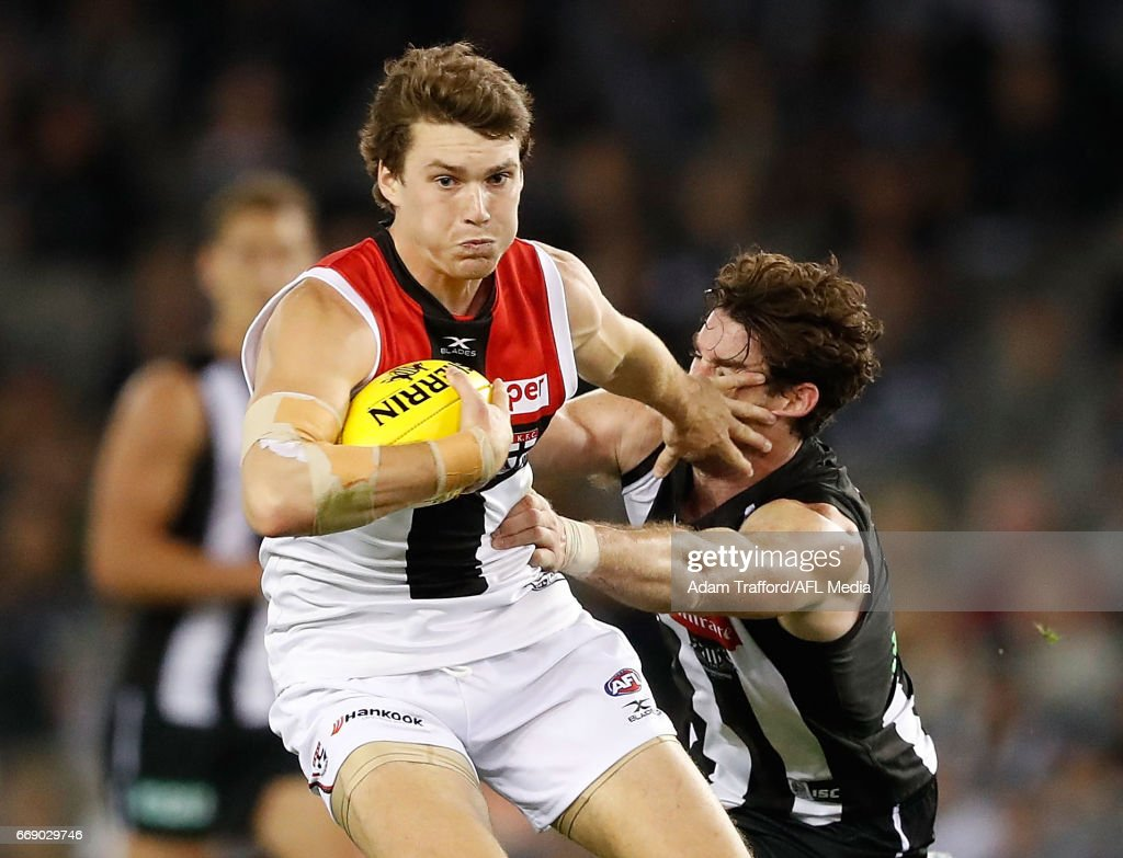 Blake Acres of the Saints is tackled by Tyson Goldsack of the Magpies during the 2017 AFL round 04 match between the Collingwood Magpies and the St Kilda Saints at Etihad Stadium on April 16, 2017 in Melbourne, Australia.