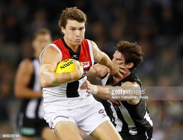 Blake Acres of the Saints is tackled by Tyson Goldsack of the Magpies during the 2017 AFL round 04 match between the Collingwood Magpies and the St...