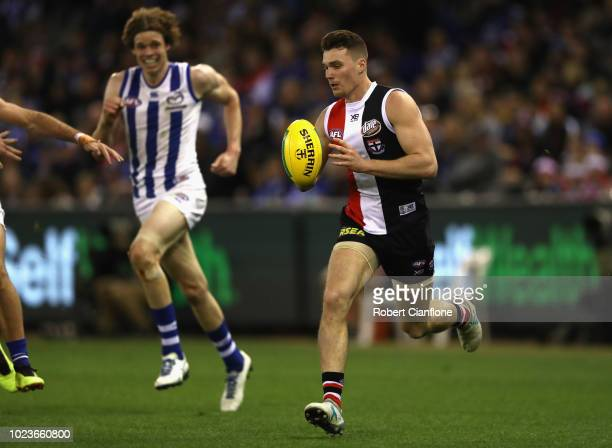Blake Acres of the Saints runs with the ball during the round 23 AFL match between the St Kilda Saints and the North Melbourne Kangaroos at Etihad...