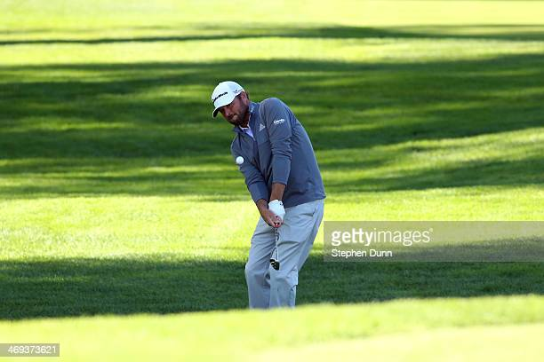 Blake Adams hits on to the green at the 11th hole in the second round of the Northern Trust Open at the Riviera Country Club on February 14, 2014 in...