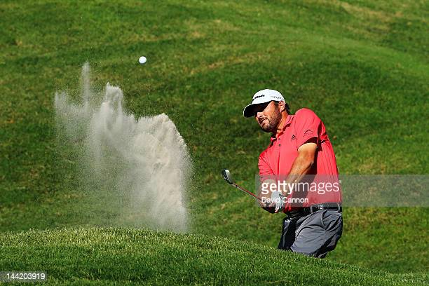 Blake Adams of the United States hits his third shot from a bunker on the ninth hole during the second round of THE PLAYERS Championship held at THE...