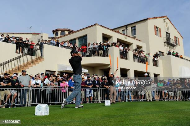 Blake Adams tees off on the first hole in the third round of the Northern Trust Open at the Riviera Country Club on February 15 2014 in Pacific...