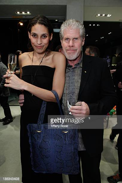 Blake Amanda and Ron Perlman attend the Opal Stone Luxury Handbags And Fine Jewelry Launch at Gray Gallery on December 8 2011 in Beverly Hills...