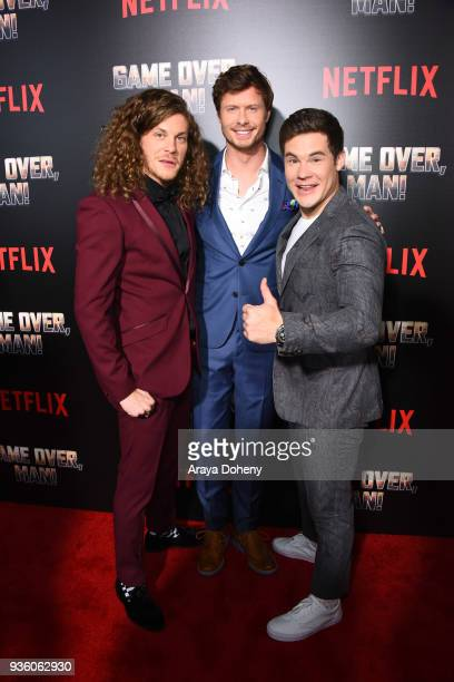 Blake Anderson Anders Holm and Adam DeVine attend the premiere of Netflix's Game Over Man at Regency Village Theatre on March 21 2018 in Westwood...