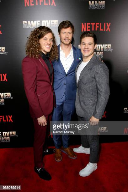 Blake Anderson Anders Holm and Adam DeVine attend the premiere of the Netflix film Game Over Man at the Regency Village Westwood in Los Angeles at...