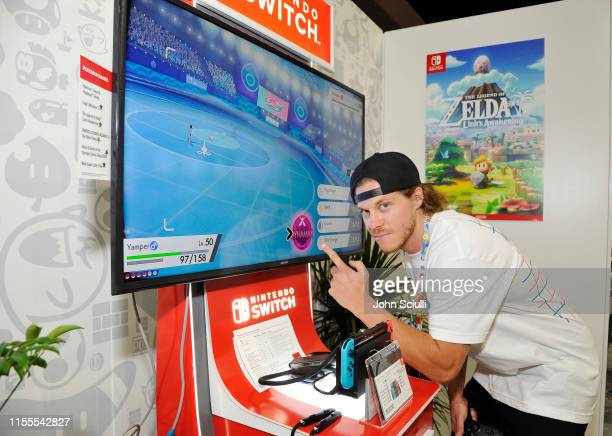 Blake Anderson checks out 'Pokémon Sword and Pokémon Shield' for the Nintendo Switch system during the 2019 E3 Gaming Convention at Los Angeles...