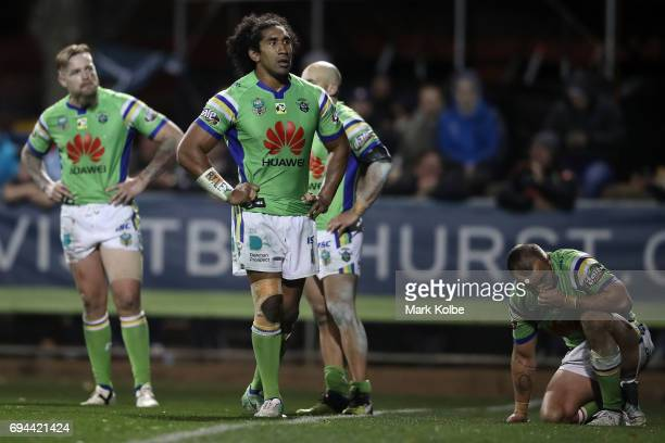Blake Austin Iosia Soliola and Josh Hodgson of the Raiders looks dejected after defeat during the round 14 NRL match between the Penrith Panthers and...