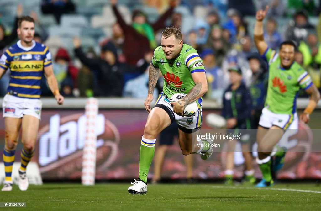 Blake Austin of the Raiders heads to the try line to score during the round six NRL match between the Canberra Raiders and the Parramatta Eels at GIO Stadium on April 14, 2018 in Canberra, Australia.
