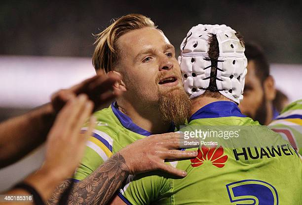 Blake Austin of the Raiders is congratulated by team mates after scoring a try during the round 18 NRL match between the Canberra Raiders and the...