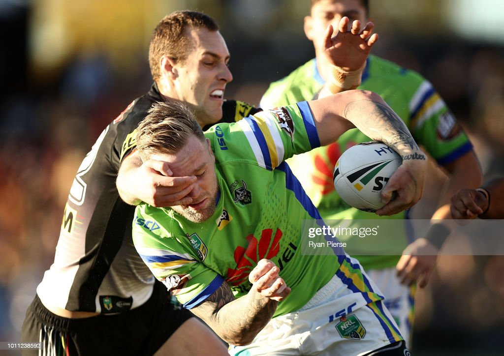 Blake Austin of the Raiders is tackled by Isaah Yeo of the Panthers during the round 21 NRL match between the Penrith Panthers and the Canberra Raiders at Panthers Stadium on August 5, 2018 in Penrith, Australia.