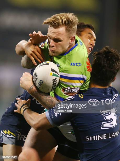 Blake Austin of the Raiders is tackled during the round 18 NRL match between the Canberra Raiders and the North Queensland Cowboys at GIO Stadium on...