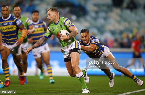Blake Austin of the Raiders is tackled during the round six NRL match between the Canberra Raiders and the Parramatta Eels at GIO Stadium on April 14...