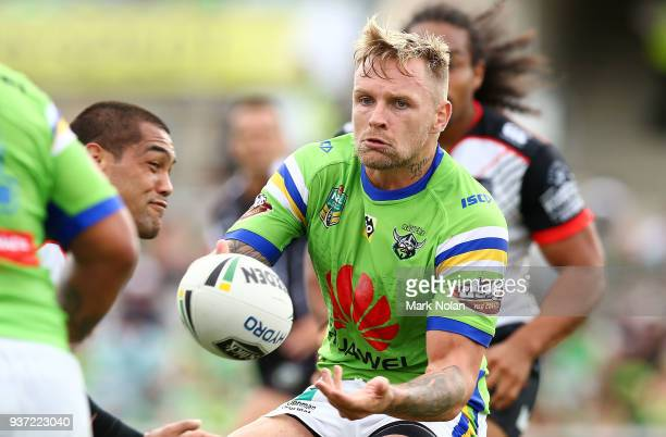 Blake Austin of the Raiders passes during the round three NRL match between the Canberra Raiders and the New Zealand Warriors at GIO Stadium on March...