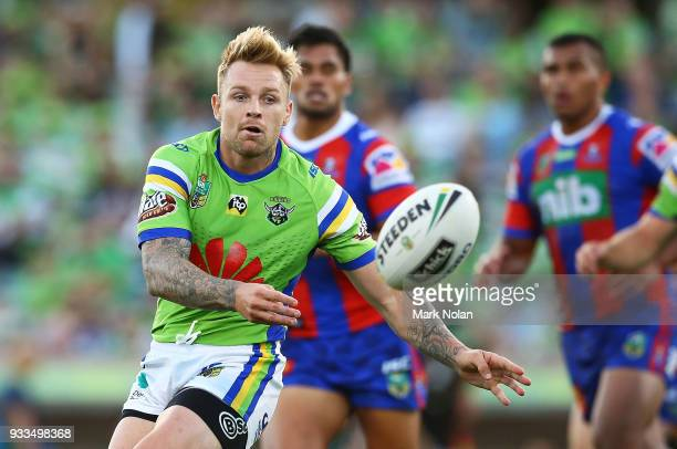 Blake Austin of the Raiders passes during the round two NRL match between the Canberra Raiders and the Newcastle Knights at GIO Stadium on March 18...