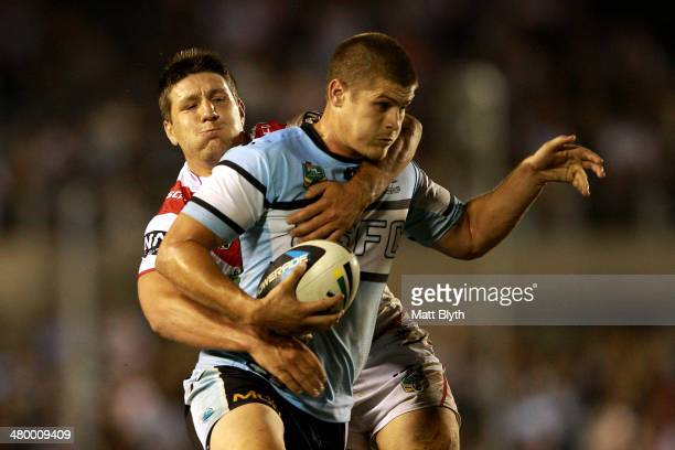 Blake Ayshford of the Sharks is tackled by Gareth Widdop of the Dragons during the round three NRL match between the CronullaSutherland Sharks and...