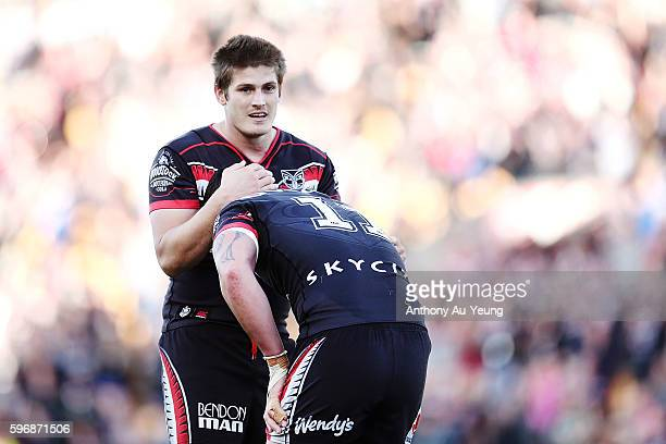 Blake Ayshford of the Warriors comforts teammate Bodene Thompson during the round 25 NRL match between the New Zealand Warriors and the Wests Tigers...