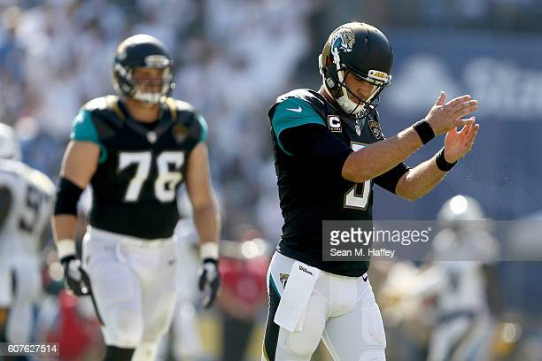 Blake Bortles claps in frustration as Luke Joeckel of the Jacksonville Jaguars walks off the field during the second half of a game against the San...