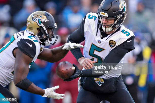 Blake Bortles hands off the ball to Leonard Fournette of the Jacksonville Jaguars throws a pass during a game against the Tennessee Titans at Nissan...