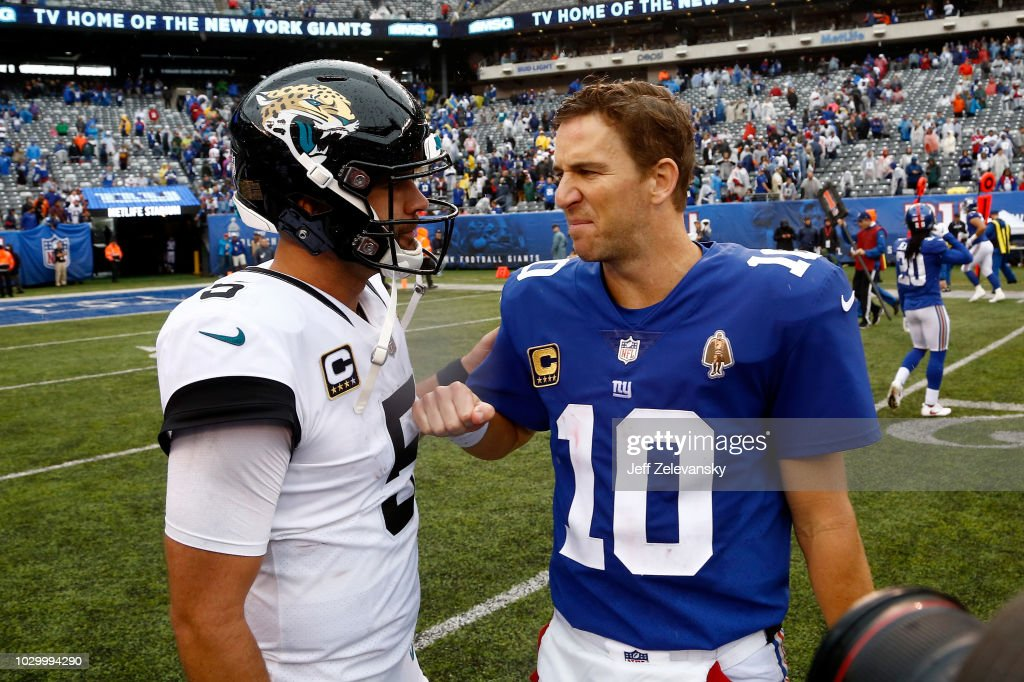 Blake Bortles #5 of the Jacksonville Jaguars and Eli Manning #10 of the New York Giants speak after their game at MetLife Stadium on September 9, 2018 in East Rutherford, New Jersey. The Jaguars defeated the Giants 20-15.