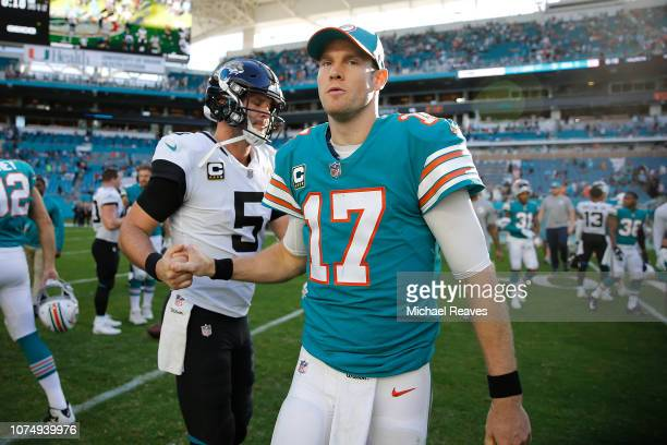 Blake Bortles of the Jacksonville Jaguars and Ryan Tannehill of the Miami Dolphins shake hands after the game at Hard Rock Stadium on December 23...