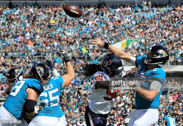 Blake Bortles of the Jacksonville Jaguars attempts a pass against Jadeveon Clowney of the Houston Texans during the game at TIAA Bank Field on...