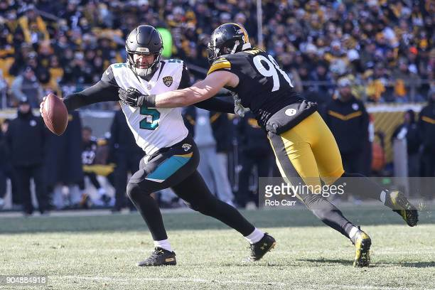 Blake Bortles of the Jacksonville Jaguars attempts to break a tackle from TJ Watt of the Pittsburgh Steelers during the first half of the AFC...