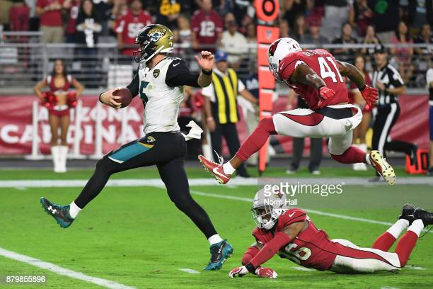 Blake Bortles of the Jacksonville Jaguars avoids a tackle by Budda Baker of the Arizona Cardinals and rushes in a 17 yard touchdown in the second...