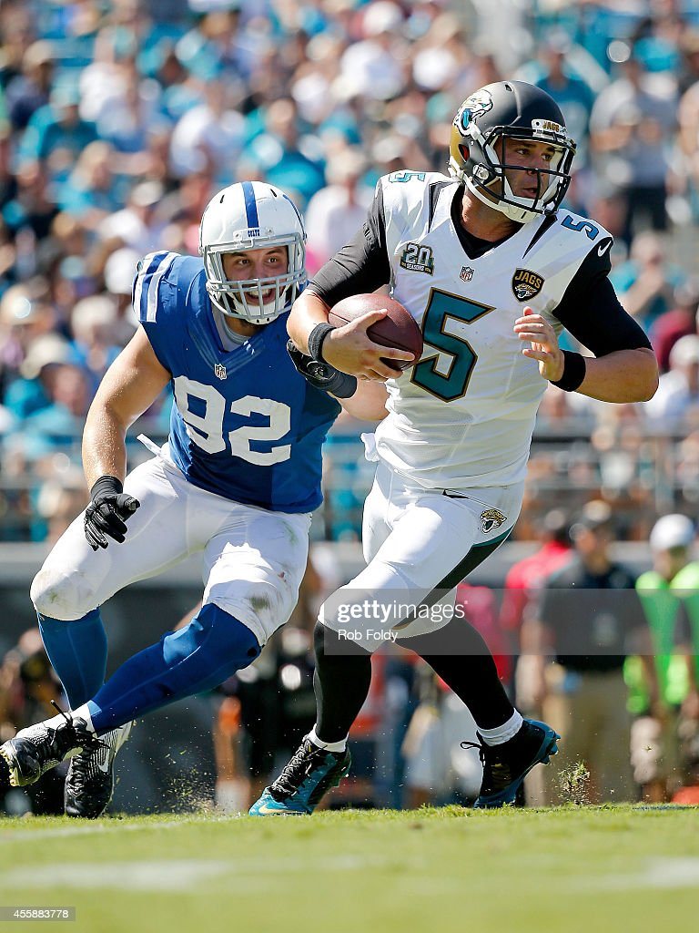 Blake Bortles #5 of the Jacksonville Jaguars avoids pressure by Bjoern Werner #92 of the Indianapolis Colts during the second half of the game at EverBank Field on September 21, 2014 in Jacksonville, Florida.