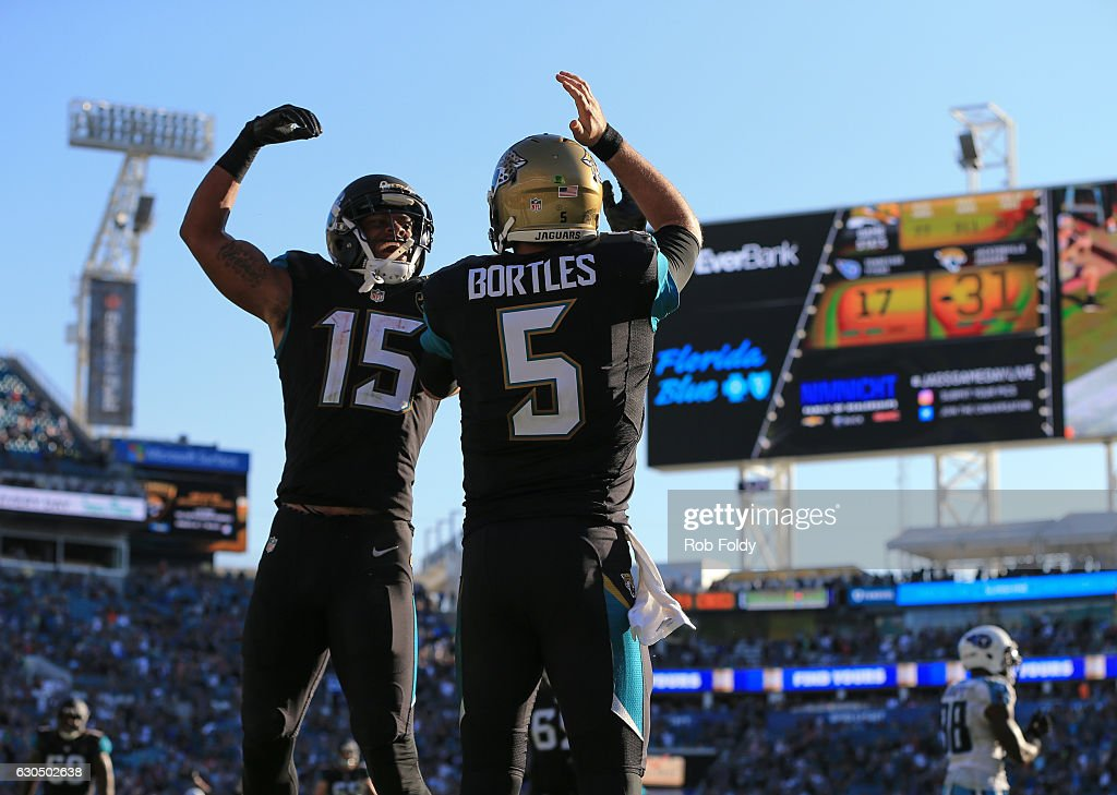 Blake Bortles #5 of the Jacksonville Jaguars celebrates with Allen Robinson #15 after scoring a touchdown off a pass from Marquise Lee, not pictured, during the fourth quarter of the game against the Tennessee Titans at EverBank Field on December 24, 2016 in Jacksonville, Florida.