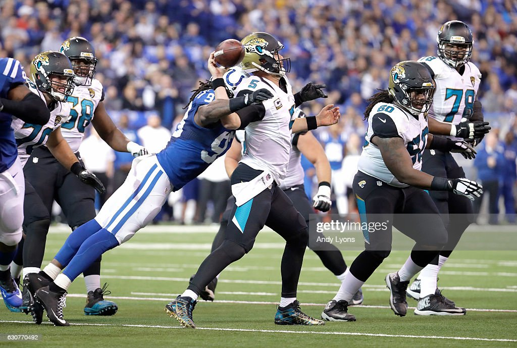 Blake Bortles #5 of the Jacksonville Jaguars fumbles the ball as he is hit by Erik Walden #93 of the Indianapolis Colts during the game at Lucas Oil Stadium on January 1, 2017 in Indianapolis, Indiana.
