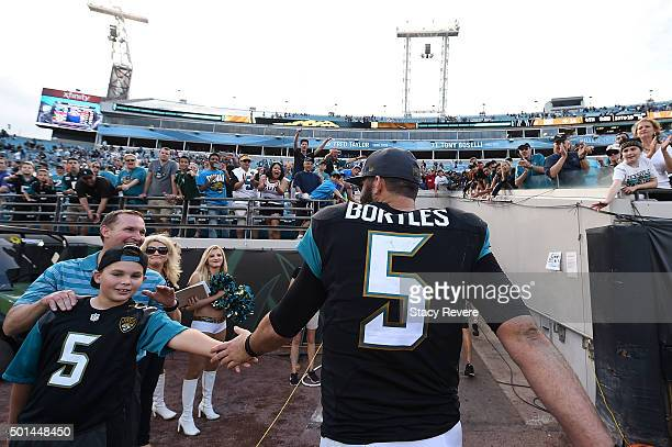 Blake Bortles of the Jacksonville Jaguars greets a fan as he leaves the field following a game against the Indianapolis Colts at EverBank Field on...