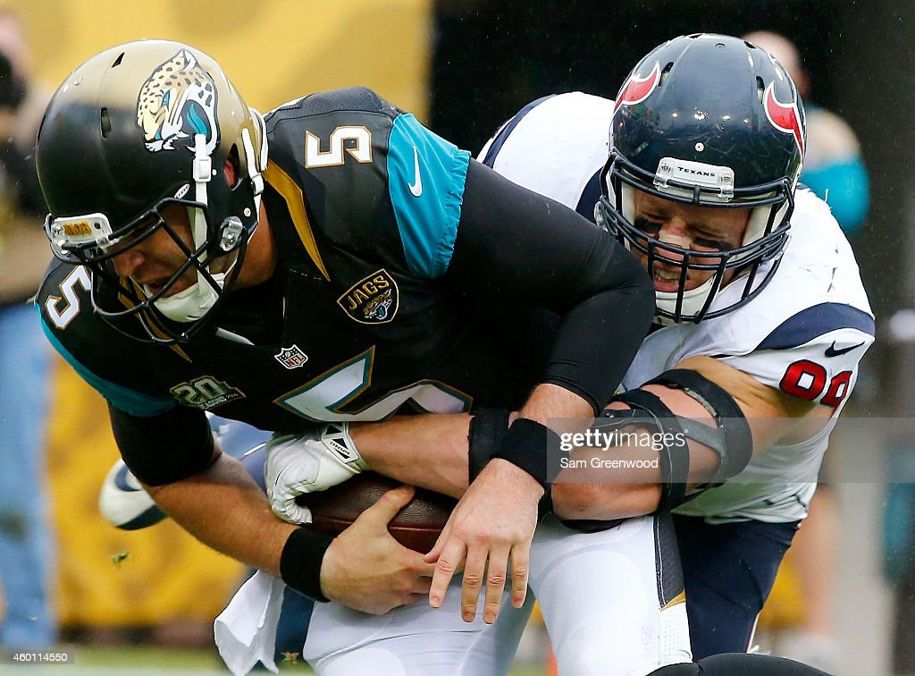 Blake Bortles #5 of the Jacksonville Jaguars is sacked by J.J. Watt #99 of the Houston Texans during the game at EverBank Field on December 7, 2014 in Jacksonville, Florida.
