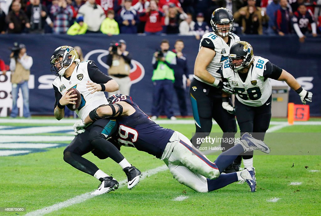 Blake Bortles #5 of the Jacksonville Jaguars is sacked by J.J. Watt #99 of the Houston Texans in the fourth quarter during their game at NRG Stadium on December 28, 2014 in Houston, Texas.